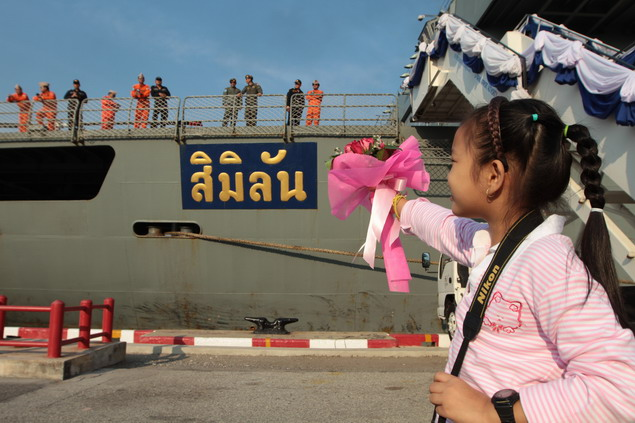The sailors' families gather at Chuk Samet naval base in Sattahip district, Chon Buri, with smiles and flowers in a welcome-home ceremony chaired by Admiral Kamthorn Phumhiran, the navy commander-in-chief.