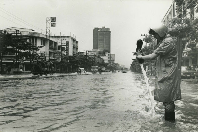 Bangkok experienced a major flood from September to December of 1983. Neither Sukhumvit Road nor this police officer avoided a drenching.