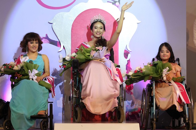 Pattarawan Panitcha (centre), a 21-year-old Thammasat University student, is crowned Miss Wheelchair Thailand 2012 at Paradise Park shopping centre in Bangkok. Photo by Somchai Poomlard.