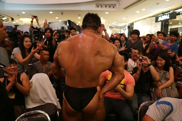 A bodybuilder displays his bulging muscles on stage at the Siam Classic 2012 men's bodybuilding contest at Central Plaza Grand Rama 9. Chanat Katanyu.