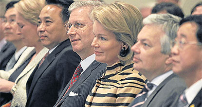 Crown Prince Philippe and Princess Mathilde (fourth and third from right) listen to the briefing at the forum entitled
