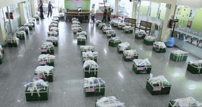 Election officials prepare ballot boxes for the byelection in Don Muang district on Sunday.