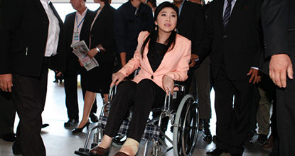 Caretaker Prime Minister Yingluck Shinawatra attends the cabinet meeting in a wheelchair in Nakhon Pathom on Tuesday, having been diagnosed with a torn ankle ligament