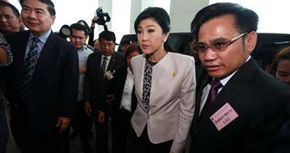 Caretaker Prime Minister Yingluck Shinawatra arrives at the National Anti-Corruption Commission head office at Sanam Bin Nam in Nonthaburi on Monday.