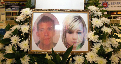 Pictures of slain tourists David Miller and Hannah Witheridge are displayed at a memorial site on Koh Tao.