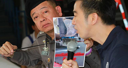 Deputy police chief Pol Gen Ruangsak Jaritek points at a picture of the body parts found in the DHL parcels, with Udomsak Hunvijit (right) of the Forensic Science Department of Chulalongkorn University explaining at a press conference at Bang Phongphang police station.