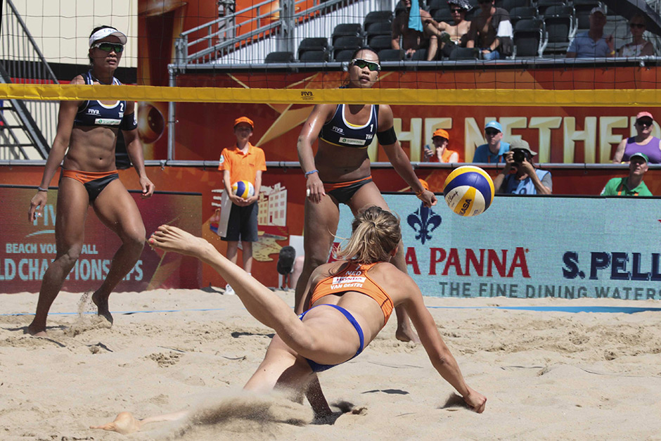 Dutch players Sophie van Gestel and Jantine van der Vlist in action against Varapatsorn Radarong and Tanarattha Udomchavee from Thailand during the Beach Volleyball World Championships 2015 in Amsterdam, Netherlands. (EPA photo)