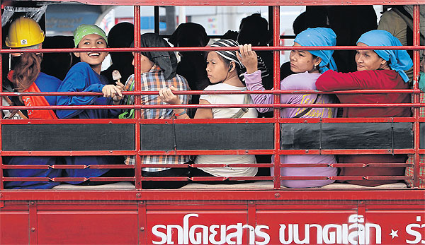 A bus carries foreign workers in Bangkok. Shortage of workers, especially in labour-intensive industries, means that Thailand may have to import more than 1 million migrant workers over the next few years.PORNPROM SATRABHAYA