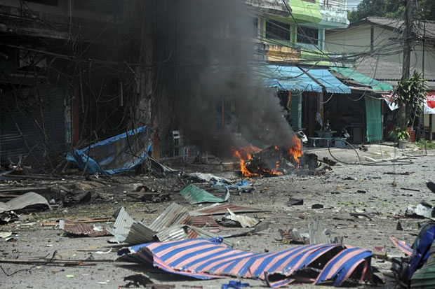 A car bomb is on fire after it was detonated by separatist militants in Narathiwat's Muang distirct on Friday. (AFP photo)
