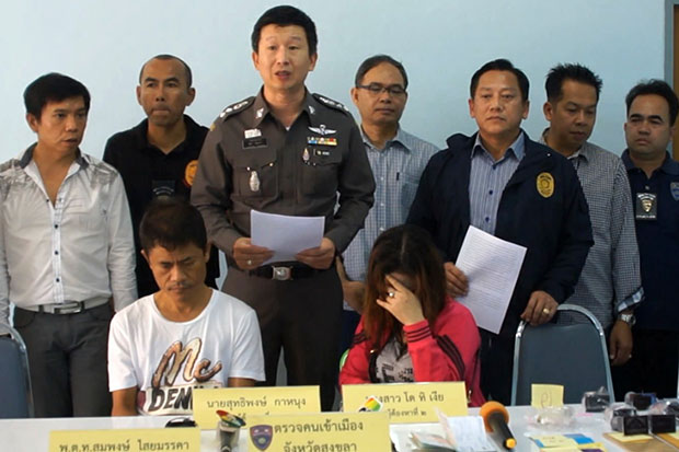 Two members of a fake visa gang and a total of 63 fake visa stamps seized from them are presented at a police press conference in Songkhla on March 11. (Photo by Wichayant Boonchote)
