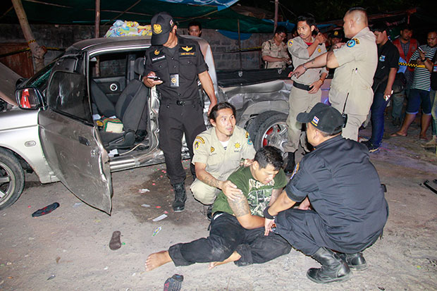 Driver Adithep Thongleum is caught after allegedly speeding past two checkpoints and hitting two Russian tourists following a police chases in Pattaya late Wednesday night. (Photo by Trinai Jansrichol)
