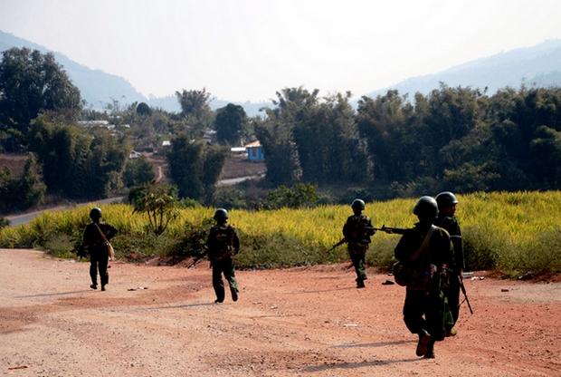 Myanmar army soldiers patrol on a road in Kokang in northeastern Shan State. (AP Photo)