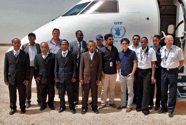 On the way home: Front row from left, Thai fishermen Kosol Daungmakkerd, Channarong Navara, Thanakon Kaeokamkong and Ton Wiyasing with United Nations staff in Galkayo after their release.