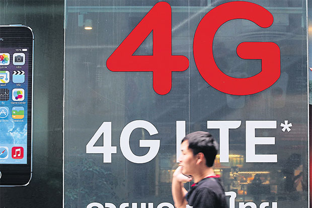 An ad displayed in Bangkok for 4G service, which has downloading speeds of up to 50 times faster than 3G. SEKSAN ROJANAMETAKUL