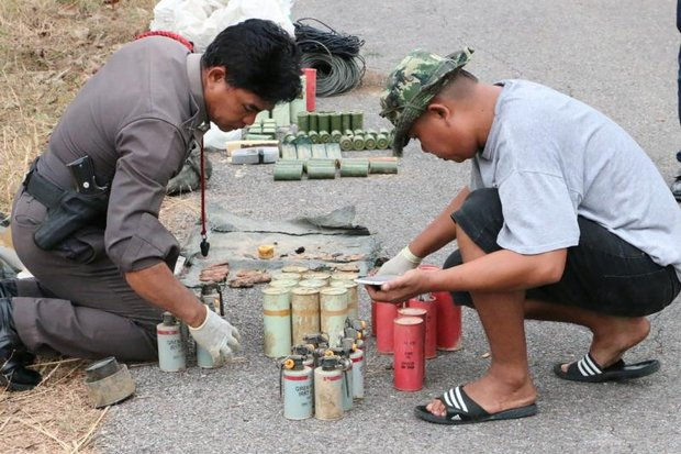 Experts examine and catalogue the collection of explosives and (foreground) smoke grenades found just outside an army camp in Prachuap Khiri Khan province. (Photo by Chaiwat Sadyeam)