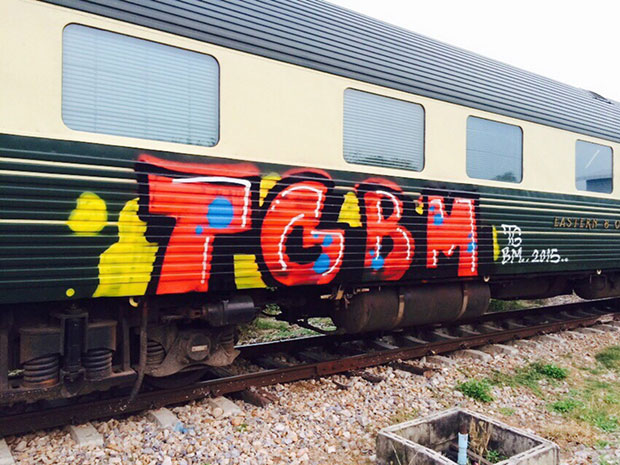 Vandals who managed to avoid CCTV cameras spray painted the letters TGBM on the luxury Oriental Express train at Kanchanaburi on Monday night. (Photos by Piyarach Chongcharoen)