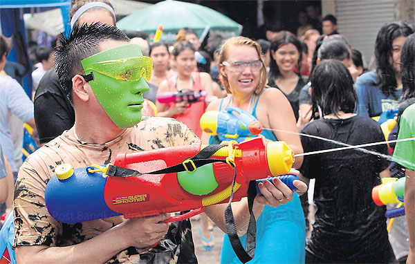 Thais and foreign tourists revel during a past Songkran.APICHART JINAKUL