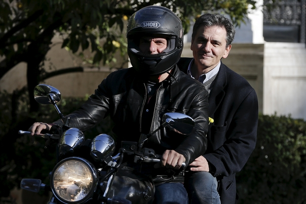 Greek Finance Minister Yanis Varoufakis (front) and deputy minister for international economic relations Euclid Tsakalotos leave the Maximos Mansion after a meeting with Prime Minister Alexis Tsipras in Athens. (Reuters Photo)