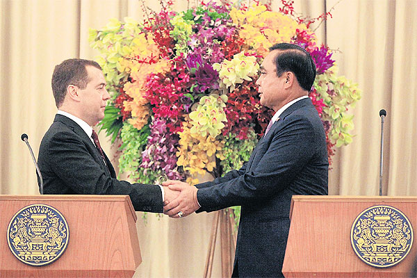 Prime Minister Prayut Chan-o-cha and his Russian counterpart Dmitry Medvedev shake hands during the signing ceremony for memorandums of understanding this week. Mr Medvedev is the first Russian prime minister to visit Thailand in 25 years.Prakit Chantawong