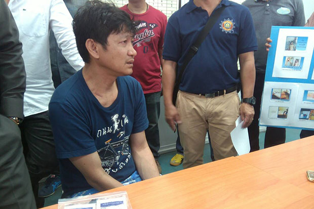 Para Chusri, 52, is shown at a police press conference on April 16. He is charged with the murder of a woman in a hotel room in Chiang Mai. (Photo by Cheewin Sattha)