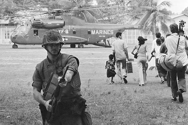 In this April 12, 1975 file photo, US marines provide cover during Operation Eagle Pull as Americans and Cambodians board marine helicopters in Phnom Penh during the final US pullout of Cambodia. Five days later, the US-backed government fell as communist Khmer Rouge guerrillas stormed into Phnom Penh. (AP photo)
