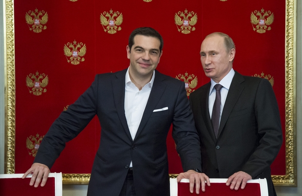 Russian President Vladimir Putin and Greek PM Alexis Tsipras chat during the latter's visit to Moscow earlier this month. Greece didn't explicitly ask the Kremlin for money but might be getting some anyway in the form of an advance payment to operate a pipeline through the country. (EPA Photo)