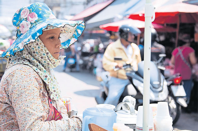 A vendor waits for customers at Klong Toey market. Household debt in Thailand soared to 85% of GDP last year and is likely to hit a record high of 90% this year.NARUPON HINSHIRANAN