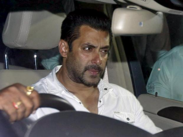 Bollywood actor Salman Khan sits in a car as he leaves aMumbai court, where he secured interim bail after being sentenced to five years on jail for a drunk-driving offence that took place 12 years ago.