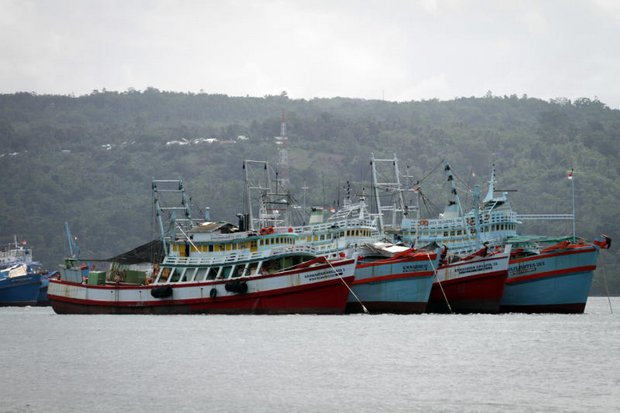 There are 75 Thai fishing boats and trawlers stranded in the Ambon Island harbour, Indonesia, as authorities there investigate illegal fishing. (Photo by Jetjaras Na Ranong)