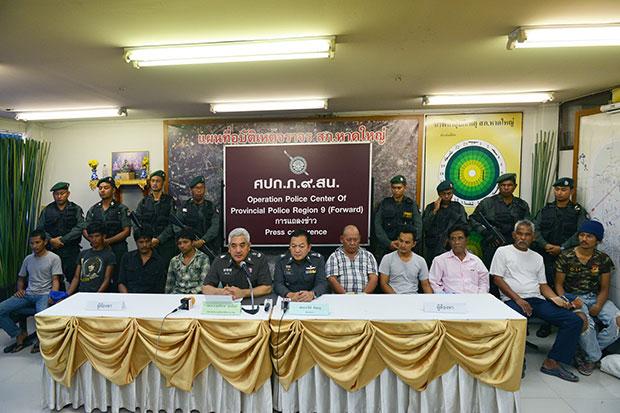 ์Nine human trafficking suspects are taken to a police press conference at the Provincial Police Region 9 on May 21. (Photo by Wichayant Boonchote)