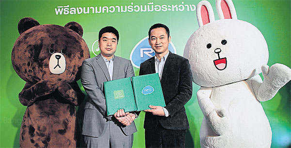 Lim Suk-jun (left), head of Line Music Global, and Soopachai Nillawan, senior executive vice-president of music for RS, pose with popular characters from the Line messaging app.