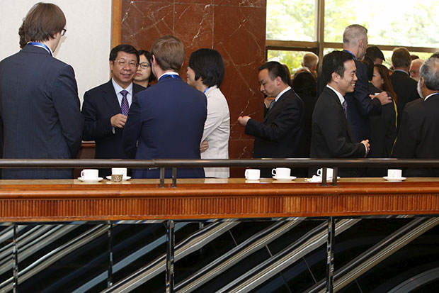 China's Vice Minister of Finance Shi Yaobin (second left) listens to delegates during a break in the Fifth Chief Negotiators' meeting which discussed draft agreements for the China-backed Asian Infrastructure Investment Bank, in Singapore May 20. (Reuters photo)