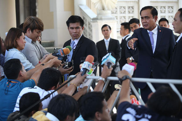Prime Minister Prayut Chan-o-cha takes questions from reporters at the Government House on Friday. (Photo by Thiti Wannamontha)