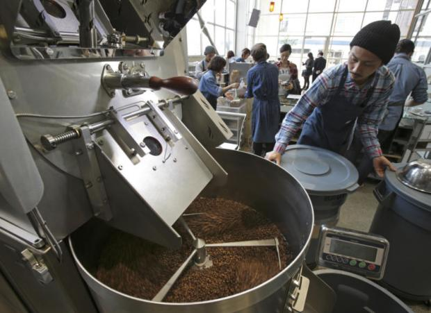 Coffee beans are roasted at the Blue Bottle coffee shop in Tokyo. (AP photo)
