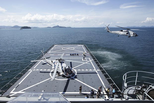 A helicopter takes off from HTMS Angthong during a drill to to provide humanitarian assistance to Rohingya and Bangladeshi migrants stranded on boats in the Andaman Sea. (Photo by Patipat Janthong)