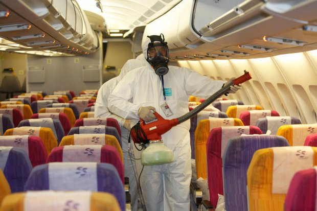 Thai Airways International workers demonstrate the procedure of disinfecting an aircraft cabin to prevent the spread of Middle East espiratory Syndrome (Mers) at Suvarnabhumi airport. (Photo by Jiraporn Kuhakan)