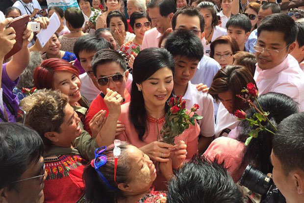 Former prime minister Yingluck Shinawatra is surrounded by supporters as she arrived at Wat Saensuk in Min Buri district on Sunday.