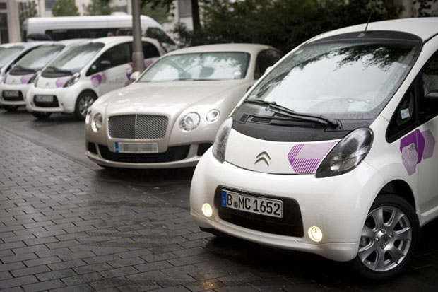 Citroen C-zero electric cars parked up next to a Bentley during the launch of a car sharing scheme in Berlin on Sept 5, 2012. (AFP photo)