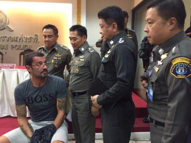 Xavier Andre Justo appears before the media yesterday after being arrested for allegedly leaking information about a Saudi energy company. (Photo from Royal Thai Police)