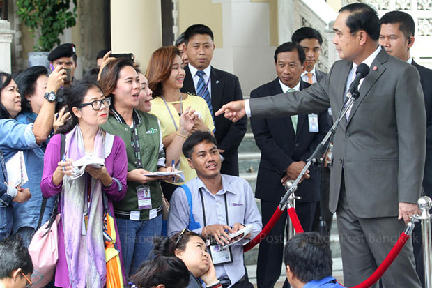 Prime Minister Prayut Chan-o-cha takes questions from reporters at Government House on Wednesday during which he said he ordered the national police chief to end his casino campaign. (Photo by Thanarak Khunton)