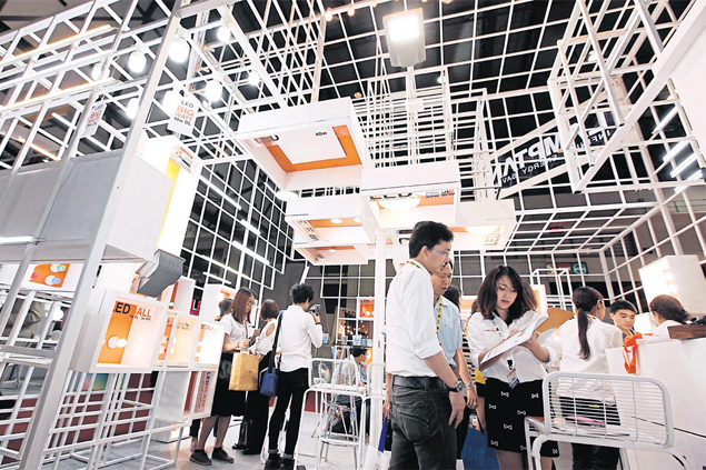 Visitors check out the many offerings at LED Expo Thailand in late May in Bangkok.