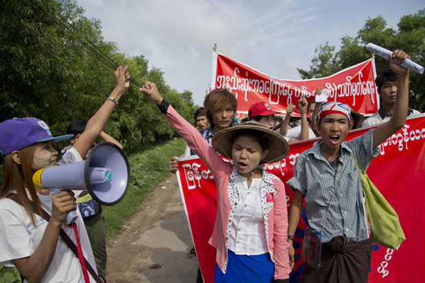 Myanmar factory workers shout slogans during a march against the proposed 3,600 kyat minimum wage, demanding 4,000 kyat, at Hlaing Thar Yar industrial zone, suburb of Yangon, on Sunday. (AP photo)