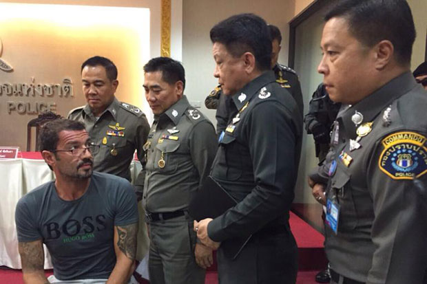 Swissman Xavier Andre Justo appears before the media on June 23, 2015, after being arrested at a house on Koh Samui. (Royal Thai Police photo)