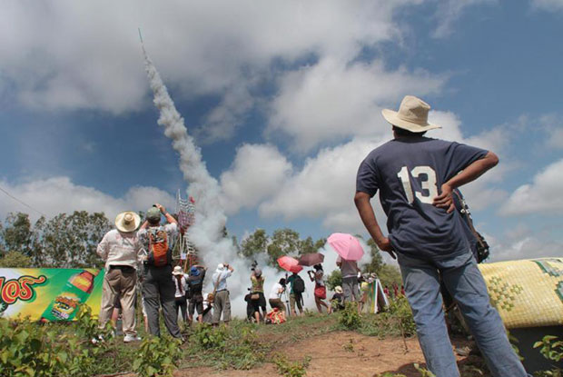 Villagers are excited by the launch of bung fai (traditional rockets) at the annual Bung Fai Festival in Yasothon province. The rockets are launched in the belief they will ensure plentiful rain for farmers. (Bangkok Post file photo)