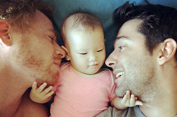 Gordon Lake, an American, and his Spanish husband, Manuel Valero, would have been banned from hiring a Thai surrogate to deliver their baby, Carmen, under a law that takes effect Thursday. (Bangkok Post photo)
