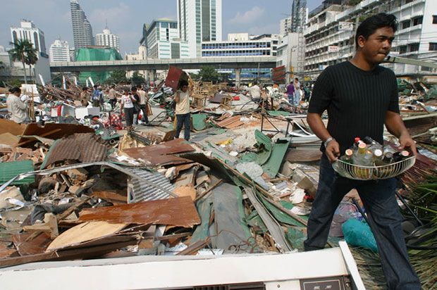In this photo taken on Jan 27, 2003, traders whose businesses at Sukhumvit Plaza were destroyed in the gangland-style rampage scour through the wreckage hoping to salvage some of their property (Bangkok Post file photo)