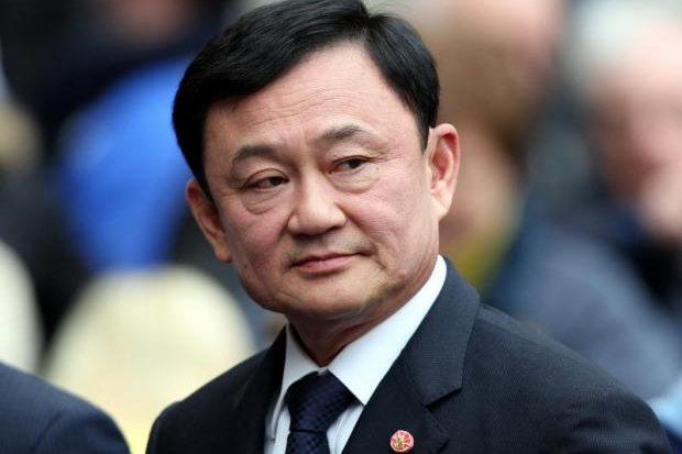 Thaksin Shinawatra appeared at a gathering on YouTube on Friday, urging his supporters to reject the draft charter. (Bangkok Post file photo)