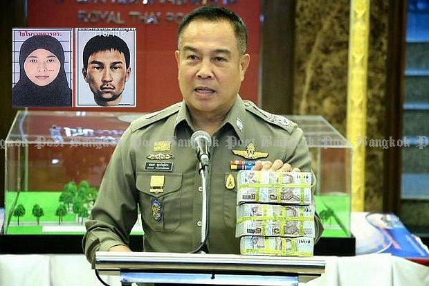 National police chief Pol Gen Somyot Poompunmuang shows bundles of cash totalling three million baht which he is paying to police detectives as a