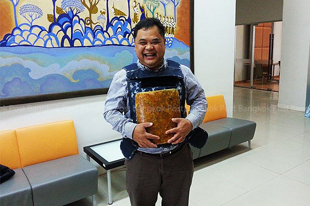 Khon Kaen University lecturer Panomkorn Khwakhong models the lightweight, bullet-proof vest made from natural silk developed by his team of researchers. (Photo by Jakkrapan Nathanri)