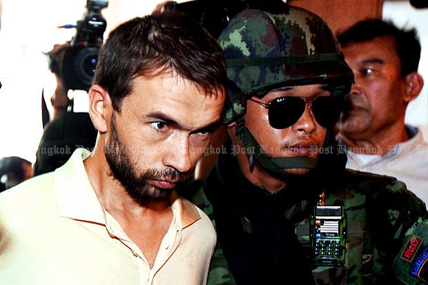The military hands over bombing suspect Adem Karadag to the Metropolitan Police Bureau on Friday after holding him for seven days. (Photo by Thiti Wannamontha)